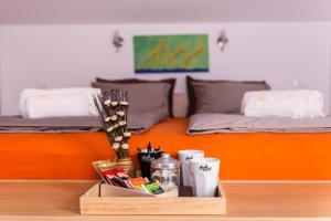 Postelja oz. postelje v sobi nastanitve Apartment and Rooms HISA SONCA