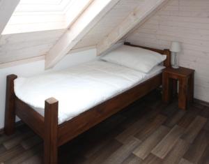 Posteľ alebo postele v izbe v ubytovaní Apartmány Stodola n.30