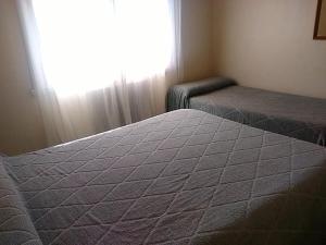 Una cama o camas en una habitación de Hotel Novo Siena