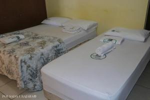 Кровать или кровати в номере Pousada Ubajara