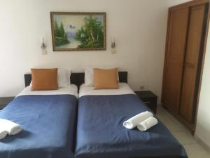 A bed or beds in a room at Hotel Kuč
