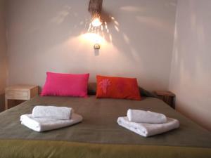 Una cama o camas en una habitación de Hosteria La Pushka