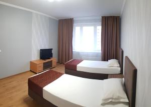 A bed or beds in a room at Баринн на Веллинга 11