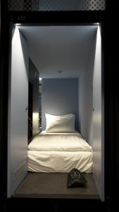 A bed or beds in a room at Capsule Transit KLIA 2 (Airside) - International Departure, Satellite Building, Level 2