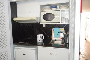 A kitchen or kitchenette at Hotel Vasco Da Gama