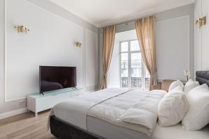 Кровать или кровати в номере Arty-Apart