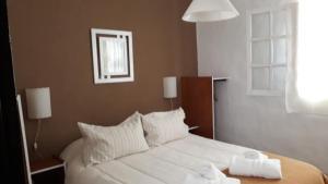 Una cama o camas en una habitación de Altos de Unzué