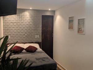 Cama ou camas em um quarto em Saquarema Itauna Beach