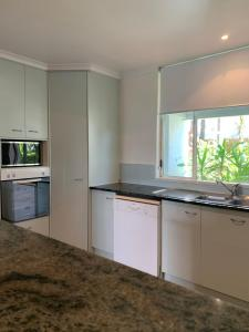 A kitchen or kitchenette at Beaches Port Douglas Holiday Apartments Book Here With The Onsite Reception Team