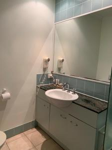 A bathroom at Beaches Port Douglas Holiday Apartments Book Here With The Onsite Reception Team
