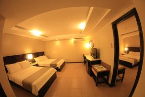A bed or beds in a room at Coron Westown Resort