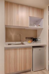 A kitchen or kitchenette at Howard Plaza Hotel Hsinchu