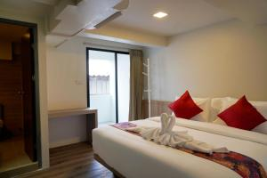 A bed or beds in a room at Wild Orchid Villa