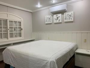 A bed or beds in a room at Linda casa em Bento Gonçalves
