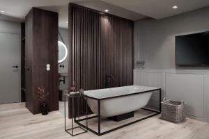 A bathroom at Hotel Rigele Royal Superior