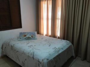 A bed or beds in a room at Casa para temporada
