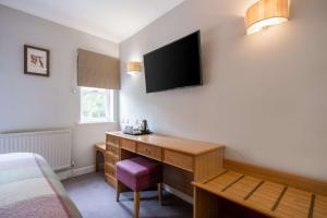 A television and/or entertainment center at Clarion Collection Hotel Makeney Hall