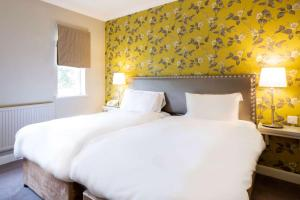 A bed or beds in a room at Clarion Collection Hotel Makeney Hall