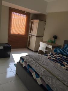 A bed or beds in a room at Apartment Mont Blanc Bekasi Timur