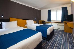 A bed or beds in a room at Holiday Inn Express Birmingham NEC
