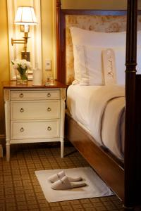 A bed or beds in a room at The Jefferson Hotel