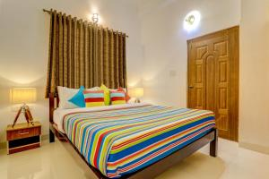 A bed or beds in a room at Ludo Villa, Pool-WiFi-Caretaker-Parking, North Goa