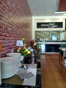 A restaurant or other place to eat at Venia Hotel Batam