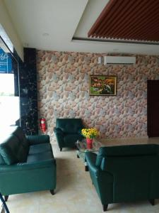 A seating area at Venia Hotel Batam