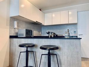 A kitchen or kitchenette at Authentic Modern 1BR In Barranco