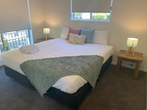 A bed or beds in a room at Harveys Beach House