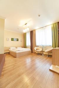 A bed or beds in a room at Hotel Merkuriy