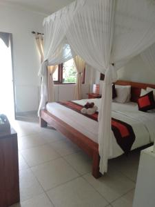A bed or beds in a room at Rama Shinta Hotel Candidasa
