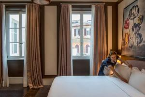A bed or beds in a room at Hotel Vilòn - Small Luxury Hotels of the World