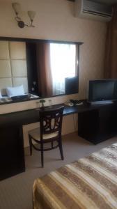 Телевизия и/или развлекателен център в Hotel Villa Ofir