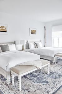 A bed or beds in a room at The Menhaden Hotel