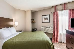 A bed or beds in a room at Quality Inn & Suites Lawrence - University Area