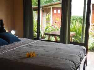 A bed or beds in a room at Essence Arenal and Spa