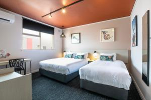 A bed or beds in a room at Nightcap at Fairfield