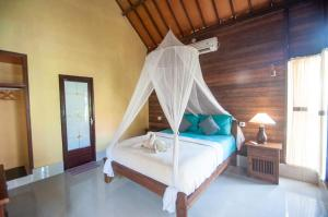 Ein Bett oder Betten in einem Zimmer der Unterkunft Timbool Bungalow