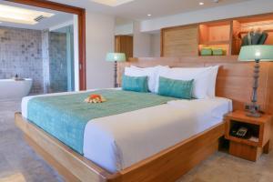 A bed or beds in a room at Amnaya Resort Benoa