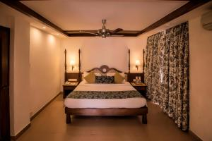 A bed or beds in a room at Adamo The Bellus
