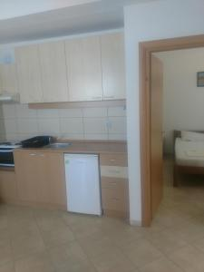 A kitchen or kitchenette at Villa Daniela Apartments