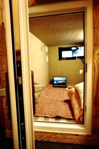 A television and/or entertainment centre at Capsule Hotel M Seoul