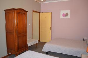 Un ou plusieurs lits dans un hébergement de l'établissement Hotel Au Picardy
