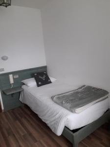 Letto o letti in una camera di Casa Salvaterra Affittacamere