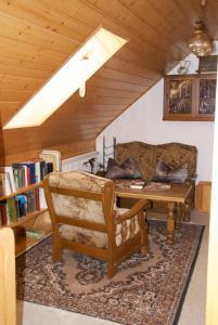 Ein Sitzbereich in der Unterkunft Gasthof Jägerheim