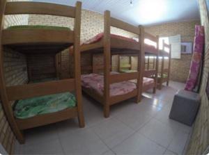 A bunk bed or bunk beds in a room at Casa Praia do Niquin Barra de São Miguel