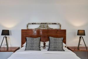 A bed or beds in a room at Almyra Guest Houses