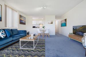 A seating area at Bushwalk To The Beach From A Tranquil Apartment