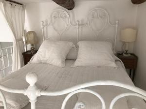 A bed or beds in a room at Maison Menton